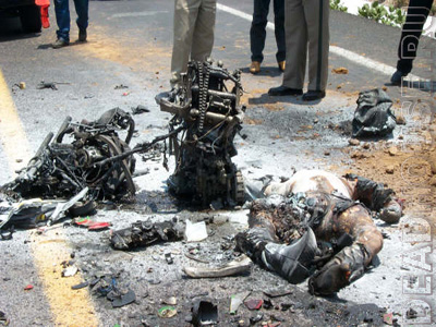 Accident with a motorcyclist. Burnt corpse