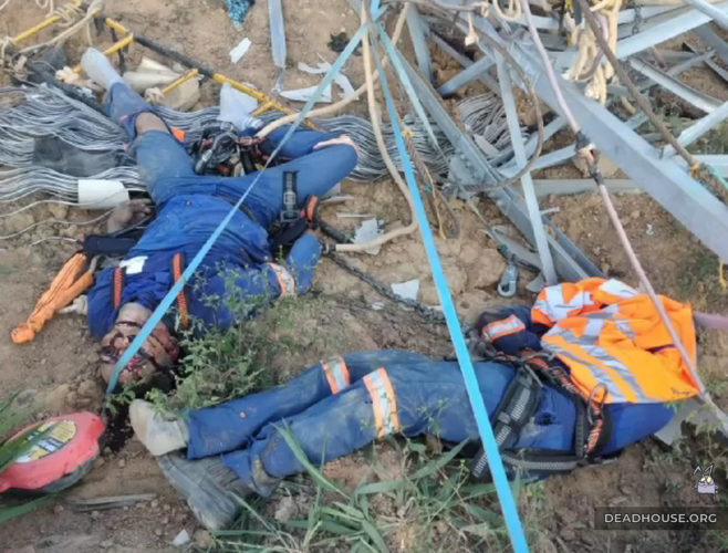 The corpse of a worker next to the debris of the power line mast
