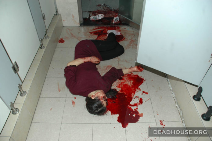 Bloody corpse in the toilet