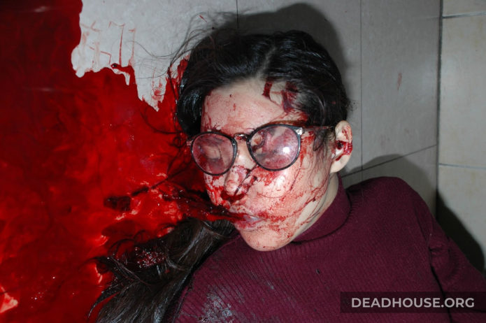 The corpse of a girl covered in blood