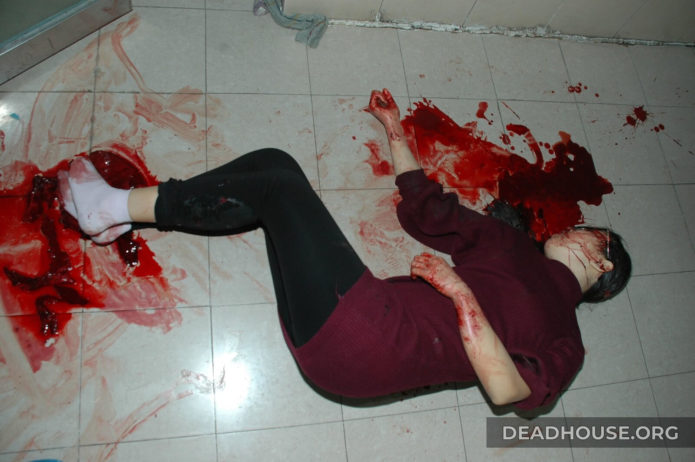 Corpse of a beautiful girl covered in blood