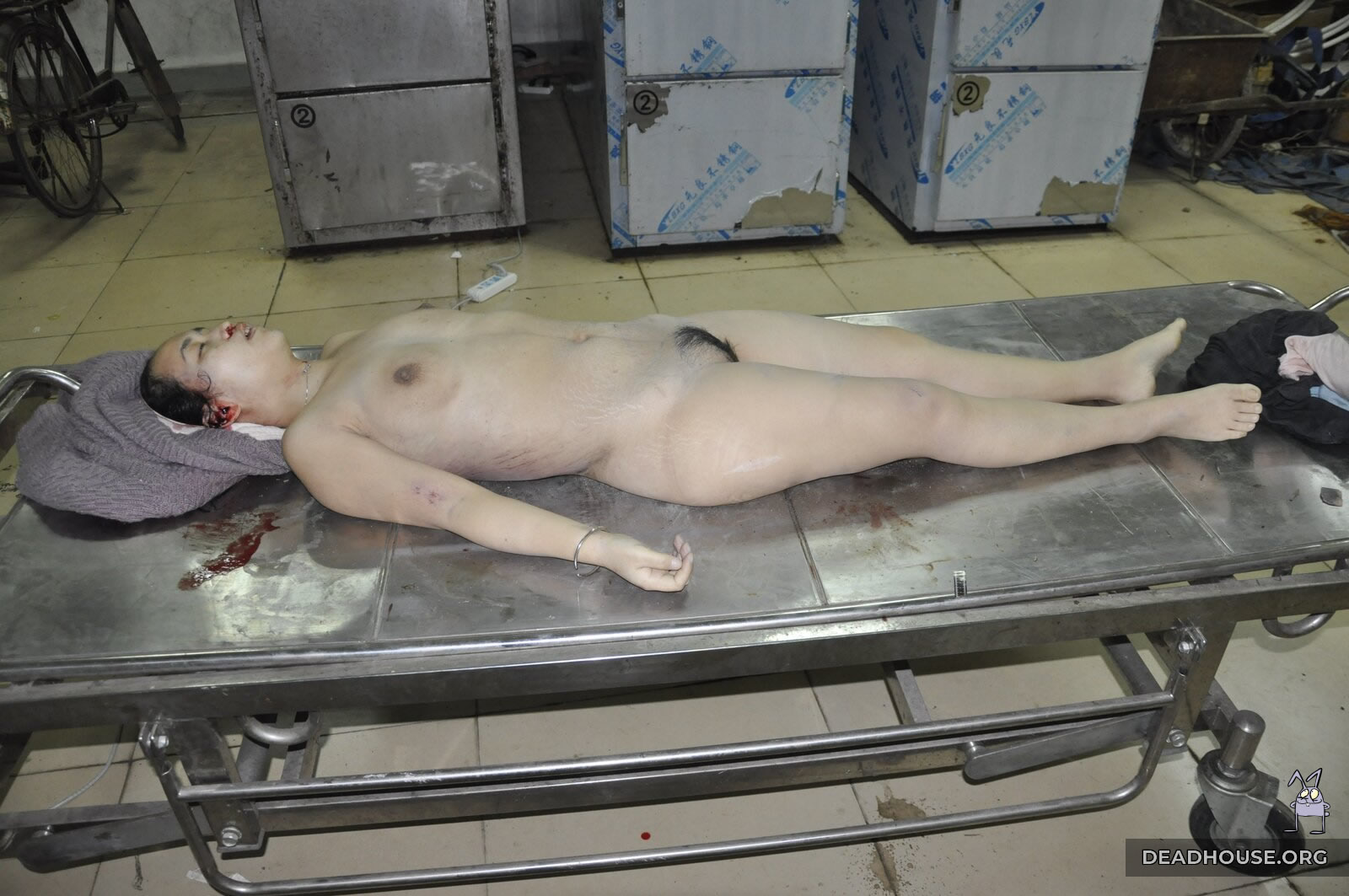 Naked girl in the morgue