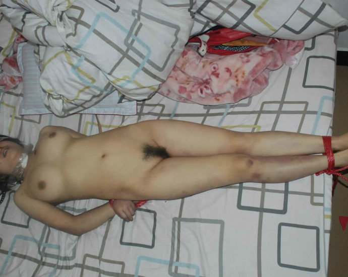 Naked corpse of a girl on the bed