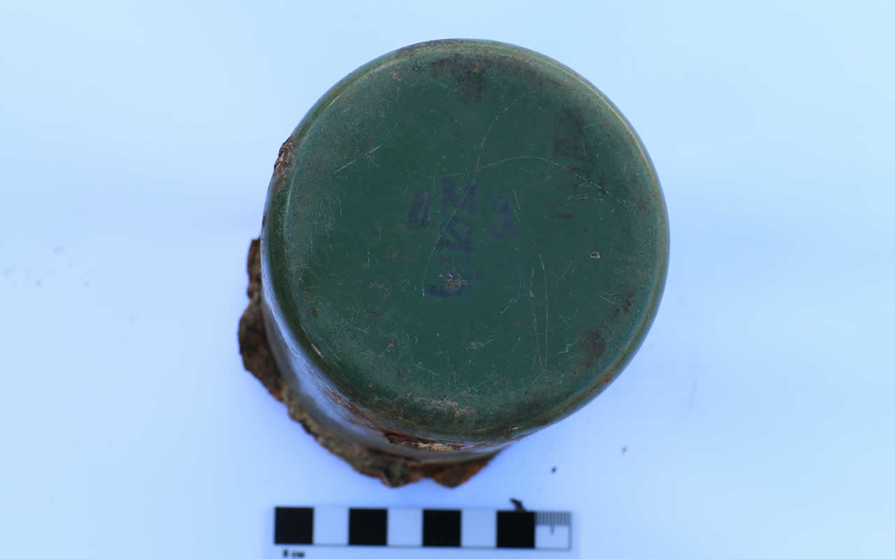 Iron mug found among the remains of the victims