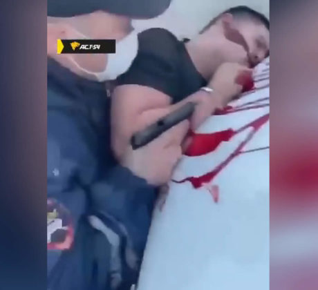 The policeman shot the detainee in the head