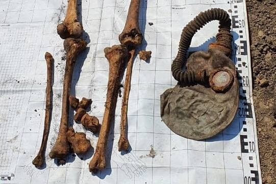 Burial bones and a gas mask
