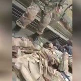 Armenian military loads corpses of Azerbaijani soldiers