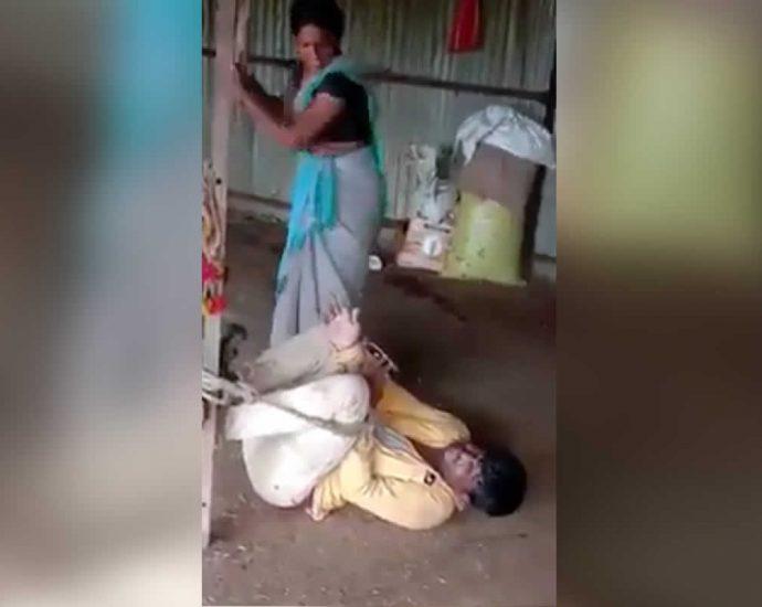 Woman beats up a man